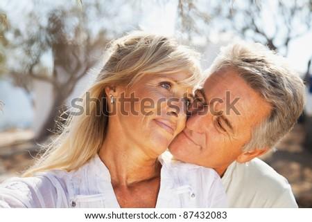 Portrait of a happy romantic couple outdoors. #87432083