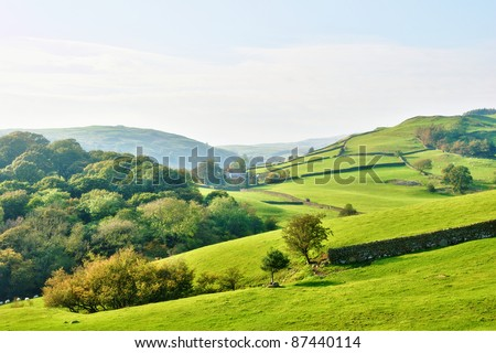 Rolling countryside around a farm Royalty-Free Stock Photo #87440114