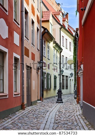 Narrow street in the old city of Riga, Latvia. In 2014, Riga is the European capital of culture #87534733