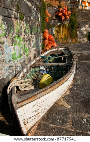 boat on the coastline in the city of naples, italy #87717541