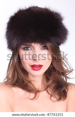 Sexy girl wearing a hat made of fur. #87761251