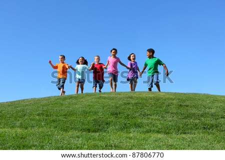 Kids running on grass hill with blue sky #87806770