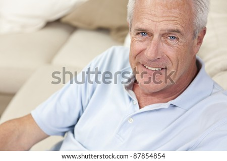Happy and healthy senior man sitting on a sofa at home smiling and happy #87854854