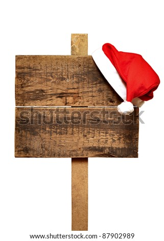 wooden road sign with Santa's hat  isolated on a white background