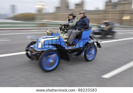 LONDON - NOVEMBER 06: London to Brighton Veteran Car Run participants crossing Westminster Bridge, on November 06, 2011 in London. #88233583
