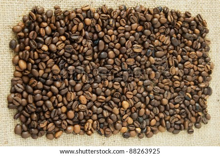 Roasted coffee beans on canvas material background #88263925