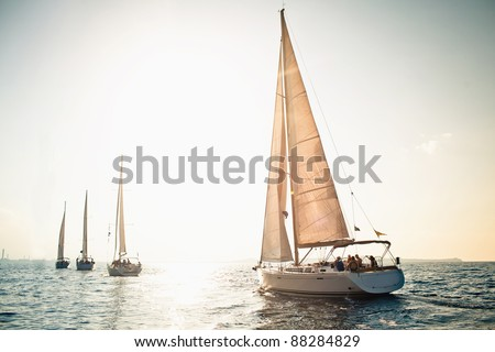Sailing ship yachts with white sails in a row Royalty-Free Stock Photo #88284829