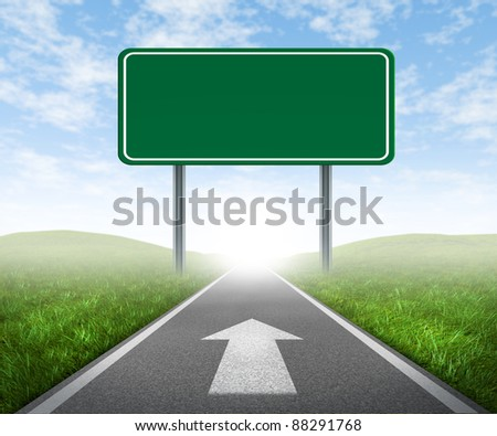 Clear goals on an open straight road highway sign with green grass and asphalt street as a concept of journey to a focused destination resulting in success and happiness with an arrow on the pavement. #88291768
