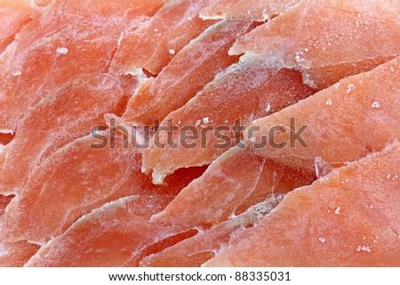 Closeup photo texture of frozen sliced raw salmon fish.  Royalty-Free Stock Photo #88335031