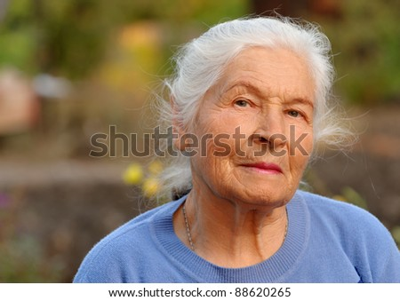 Portrait of the elderly woman. A photo on outdoors #88620265