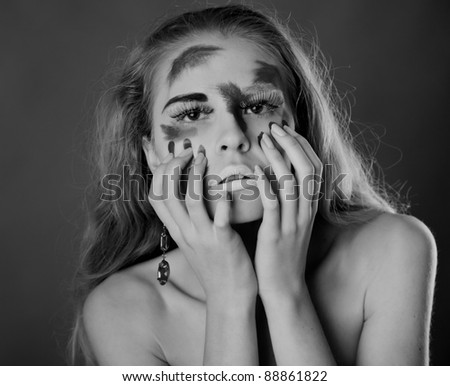A woman with unusual make-up. Black and white #88861822