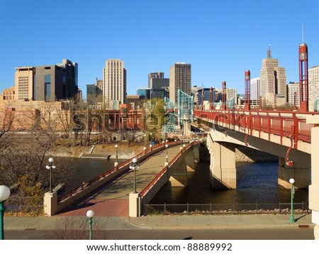 A picture of bridges leading into the St. Paul Minnesota skyline
