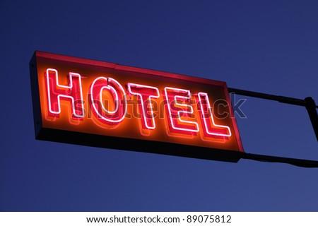 Hotel sign illuminated at night