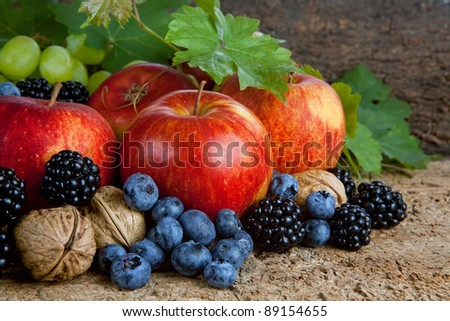 Still life for thanksgiving with autumn fruits, nuts and berries #89154655