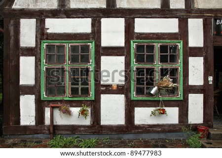 Widows of half-timbering medieval house in Klaipeda, Lithuania. #89477983