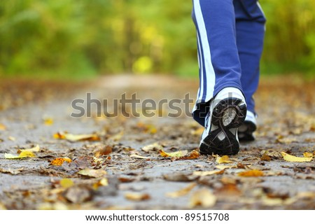 Woman walking cross country and trail in autumn forest #89515708