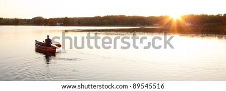 Canoe on Lake with Setting Sun #89545516