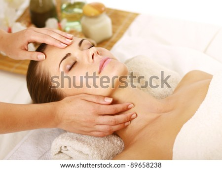 Portrait of Fresh and Beautiful brunette woman taking head massage isolated on white background #89658238