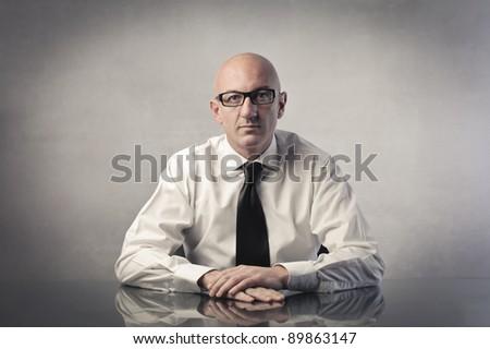 Businessman sitting at a desk #89863147
