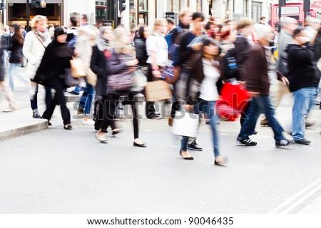 shopping people crossing a street in London