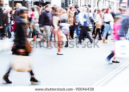 shopping people walking on the pedestrian crossing