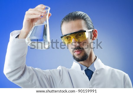 Young chemist student working in lab #90159991