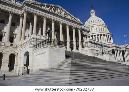 The Capitol, located in Washington, DC, is the building in which the US Congress meets. It is at the east end of the National Mall #90282739
