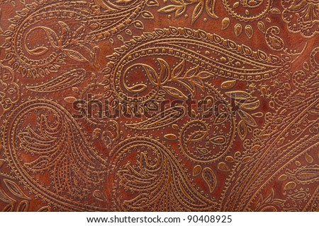 Tooled floral pattern in brown leather