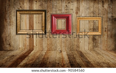 Western saloon floor and wall with empty picture frames.
