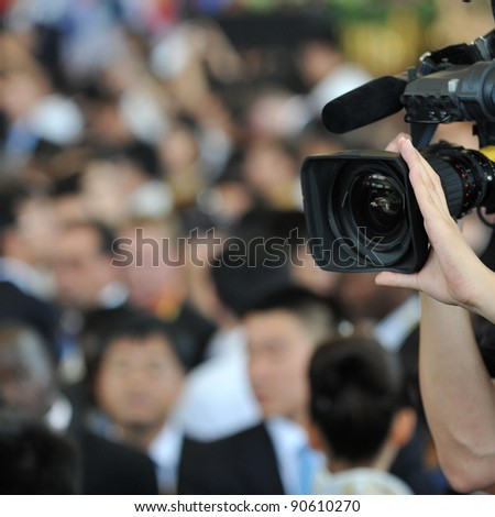 Live broadcasting, television operator with camera. Selective focus on hand #90610270