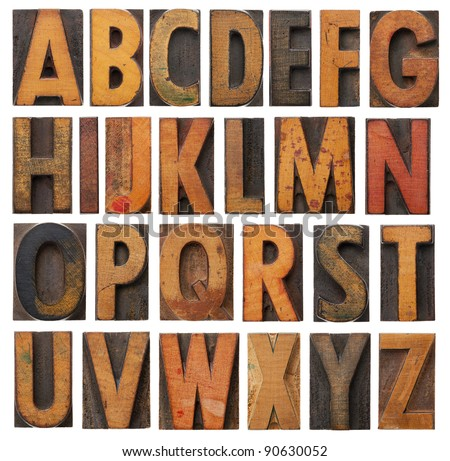 complete English alphabet - collage of 26 isolated vintage wood letterpress printing blocks, scratched and stained by ink patina