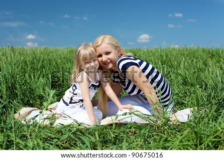 mother with her daughter outdoors in summer day #90675016