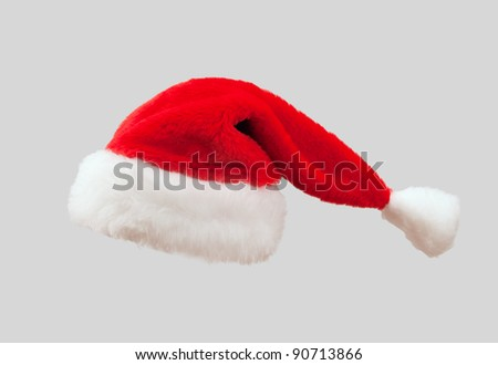 The red Santa Claus hat. Isolated on gray background. #90713866