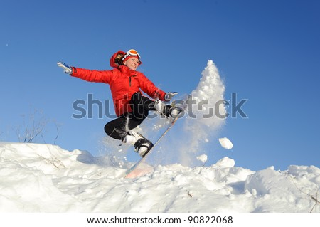 Pretty active young woman in red clothing on snowboard #90822068