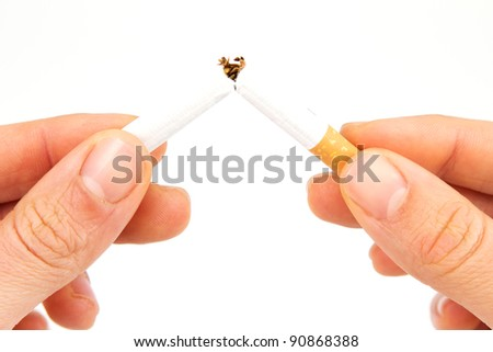 Two hands breaking a cigarette in half in front of a white background #90868388