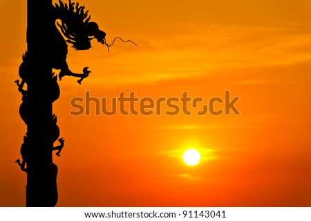 Silhouette of dragon statue with sunset #91143041
