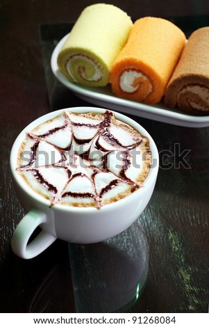 hot cappuccino, coffee in white cup and cream roll #91268084