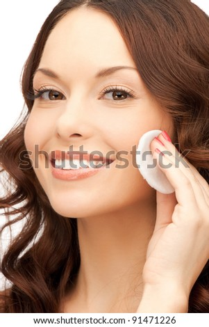 bright closeup portrait picture of beautiful woman with cotton pad #91471226