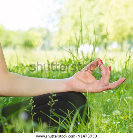Close up of woman hand during meditation outdoors. #91475930