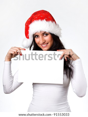 beautiful girl in a Santa Claus hat with a clean sheet of paper on a white background #91553033
