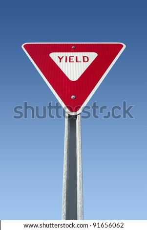Yield sign on blue sky, isolated with clipping path