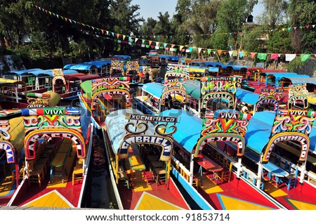 Colorful Mexican gondolas at Xochimilco's Floating Gardens in Mexico City, Mexico. No people. Copy space #91853714