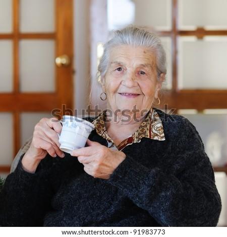 Senior woman having a cup of tea #91983773