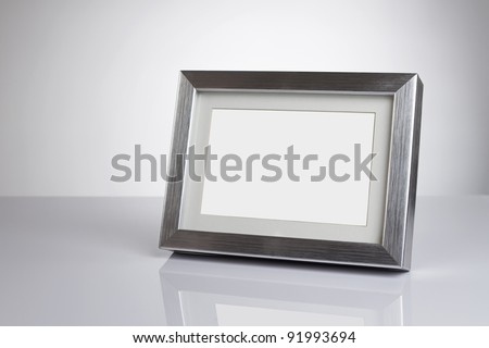 Blank silver picture frame at the desk with clipping path