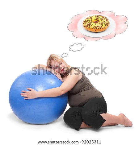 Funny picture of a hungry overweight woman practising with ball. Health care concept.