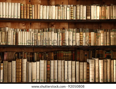 three rows of old books on a shelf #92050808