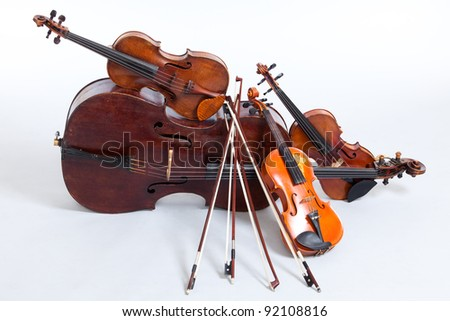 Cello and three violins, all vintage instruments. Royalty-Free Stock Photo #92108816