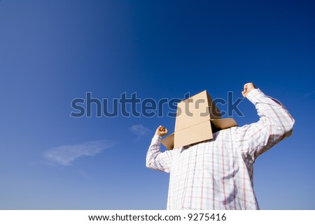 a young man with a cardboard hiding his head #9275416