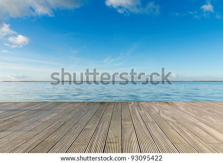 Dreaming on a empty wooden pier #93095422