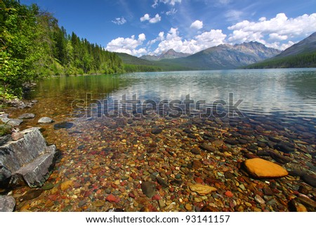 Brightly colored rocks seen through the crystal clear waters of Kintla Lake in Glacier National Park - USA #93141157